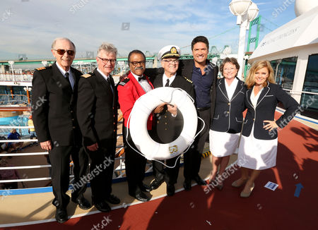 Left to right, Bernie Kopell, Fred Grandy, Ted Lange, Gavin MacLeod, Louis Aguirre, co-host of The Insider, Lauren Tewes and Jill Whelan join Princess Cruises to celebrate their 50th anniversary with the original cast of The Love Boat aboard Pacific Princess at the Port of Los Angeles on Thurs., in Los Angeles
