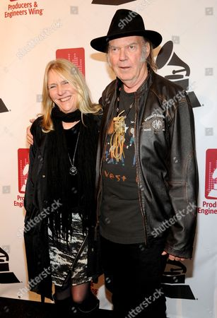Honoree Neil Young, right, and Pegi Young arrive at the Producers and Engineers of The Academy's 7th Annual Grammy Week Event, at The Village Recording Studios,, in Los Angeles