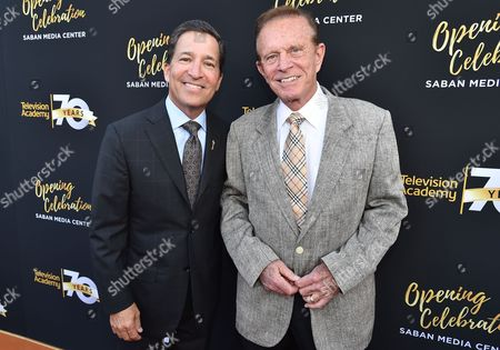 Bruce Rosenblum, Television Academy Chairman and CEO, left, and Bob Eubanks arrive at the Television Academy's 70th Anniversary Gala and Opening Celebration for its new Saban Media Center, in the NoHo Arts District in Los Angeles