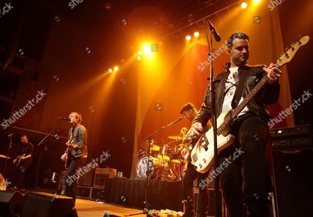 Alex Rosamilia, from left, Brian Fallon, Benny Horowitz, Ian Perkins and Alex Levine of the band The Gaslight Anthem perform in concert during their Get Hurt Tour 2015 at Rams Head Live, in Baltimore