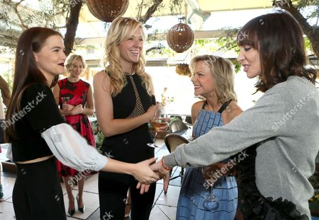 From left, Zoey Deutch, Tara Swennen, Carol McColgin and Merle Ginsberg attend The Hollywood Reporter & Jimmy Choo Celebration of the Most Powerful Stylists in Hollywood,, in West Hollywood, Calif