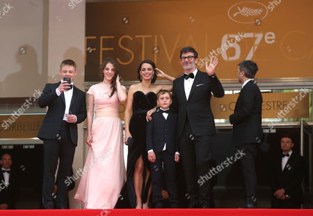 From left, Maxim Emelianov, Zukhra Duishvili, Berenice Bejo, Abdul-Khalim Mamatsuiev, Michel Hazanavicius and Thomas Langmann arrive on the red carpet for the screening of The Search at the 67th international film festival, Cannes, southern France