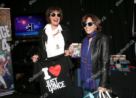 Darian Shapiro and Dick Clark Productions President Orly Adelson attend Ubisoft's Just dance 4 and The Hip Hop Dance Experience Gifting Suite at the American Music Awards at the Nokia Theater on in Los Angeles, California
