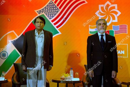 Afghanistan's Chief Executive Abdullah Abdullah, right, with Indian Commerce Minister Suresh Prabhu stand as Indian national anthem is played during an India-Afghanistan trade conference in New Delhi, India, . Abdullah is in the country for a three day India-Afghanistan trade and investment show