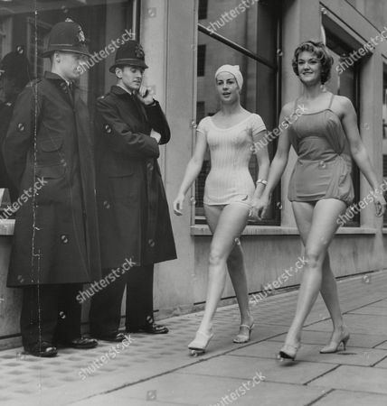 Two Policemen In Saville Row Watching Models Sylvia Mvgregor (l) And Margaret Byrne (r) Wearing The Latest Swimsuits. Sylvia Is Wearing The Cha-cha-cha And Margaret The Medina. Box 737 310031748 A.jpg.
