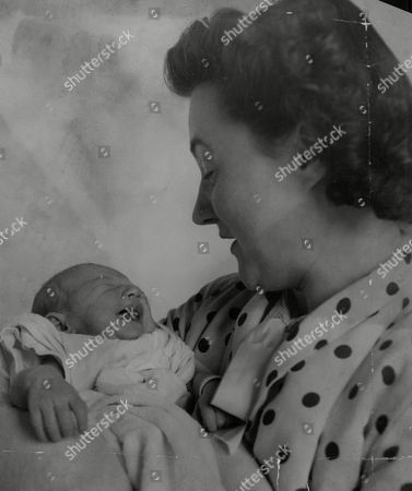 Mrs Olive Carter Wife Of Tennis Player Roland Carter After The Birth Of Their Baby Daughter Pamela Jean. Box 740 217031725 A.jpg.