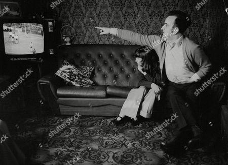 Stock Image of P.c. Edward Carrington At Home With His Daughter Sandra. P.c. Carrington Was Pictured Being Beaten Up By The Spurs And Chelsea Football Fans. Box 740 717031721 A.jpg.