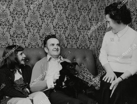 Editorial photo of P.c. Edward Carrington At Home With His Wife Diva And Their Daughter Sandra. P.c. Carrington Was Pictured Being Beaten Up By The Spurs And Chelsea Football Fans. Box 740 717031722 A.jpg.