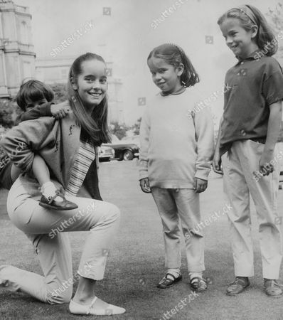 Stock Photo of Children Of Actor Charlie Chaplin At Eastbourne. Victoria Chaplin 15 With Christopher 4 On Her Back Jane 9 And Annette 6. Box 743 331031725 A.jpg.