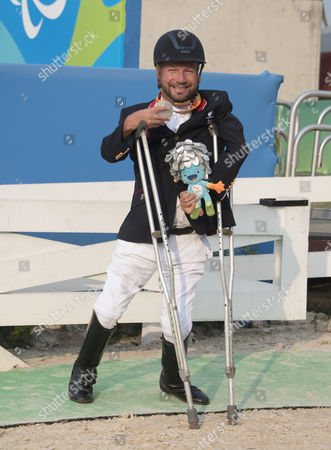 Stock Photo of Lee Pearson. British Paralympian Equestrian Lee Pearson Who Carried The Flag In The Paralympic Opening Ceremony Pictured With His Silver Medal Won In The Individual Championship Test On His Horse Zion.