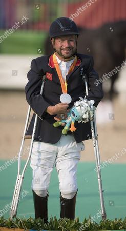 Editorial image of Lee Pearson. British Paralympian Equestrian Lee Pearson Who Carried The Flag In The Paralympic Opening Ceremony Pictured With His Silver Medal Won In The Individual Championship Test On His Horse Zion.