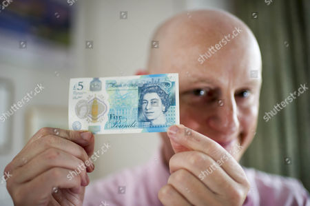 The New £5 Note. Harry Mount With The New Indestructible Plastic Five Pound Note Released Into Circulation 13th September 2016. Harry Tries Various Methods To Destroy It Including A Dishwasher Oven Washing Machine Iron Crumpling Folding Sofa Squash Food Staining And Burning To Road Test The New Addition To The Stirling Family.