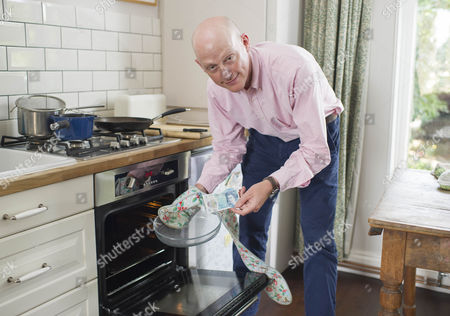 The New £5 Note. Harry Mount With The New Indestructible Plastic Five Pound Note Released Into Circulation 13th September 2016. Harry Tries Various Methods To Destroy It Including A Dishwasher Oven Washing Machine Iron Crumpling Folding Sofa Squash Food Staining And Burning To Road Test The New Addition To The Stirling Family. Pictured Shows:- Harry Putting The Note In The Oven.