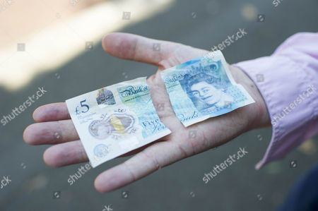 The New £5 Note. Harry Mount With The New Indestructible Plastic Five Pound Note Released Into Circulation 13th September 2016. Harry Tries Various Methods To Destroy It Including A Dishwasher Oven Washing Machine Iron Crumpling Folding Sofa Squash Food Staining And Burning To Road Test The New Addition To The Stirling Family. Pictured Shows:- Harry After He Ripped The Note With His Teeth.