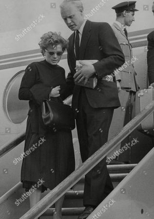 Racing Driver Mike Hawthorne Escorting Louise Collins Widow Of His Team Mate Peter Collins Back To Britain After Her Husband Was Killed At The 1958 German Grand Prix. Box 738 314031718 A.jpg.