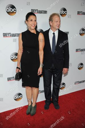 "Linda Lowy, left, and Jeff Perry arrive at ""Grey's Anatomy"" 200th Episode event at The Colony on in Los Angeles"