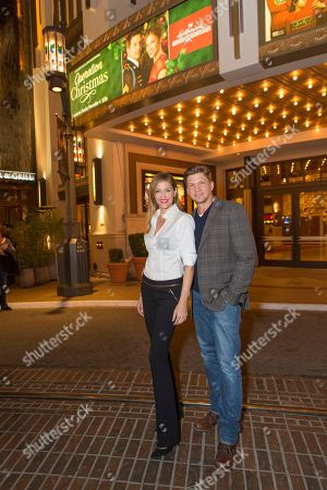 """Tricia Helfer, left, and Marc Blucas attend a screening for Hallmark Movies & Mysteries """"Operation Christmas"""" at The Gove on in Los Angeles"""