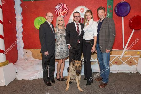 """Bill Abbott, from left, Michelle Vicary, Captain Jason Haag with service dog Axel, Tricia Helfer and Marc Blucas attend a screening for Hallmark Movies & Mysteries """"Operation Christmas"""" at The Gove on in Los Angeles"""