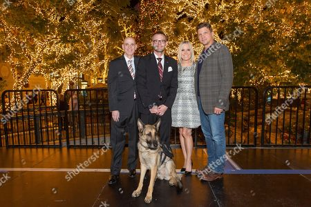 """Bill Abbott, from left, Captain Jason Haag, service dog Axel, Michelle Vicary and Marc Blucas attend a screening for Hallmark Movies & Mysteries """"Operation Christmas"""" at The Gove on in Los Angeles"""