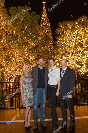 """Michelle Vicary, from left, Marc Blucas, Tricia Helfer, and Bill Abbot attend a screening for Hallmark Movies & Mysteries """"Operation Christmas"""" at The Gove on in Los Angeles"""
