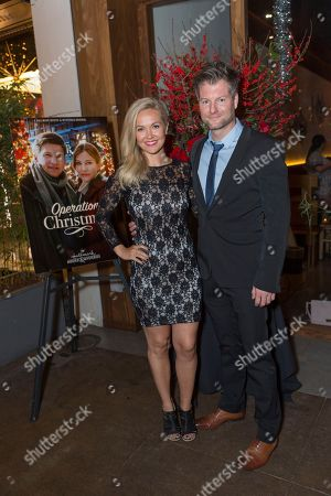 "Emilie Ullerup, left, and Kyle Cassie attend a screening for Hallmark Movies & Mysteries ""Operation Christmas"" at The Gove on in Los Angeles"