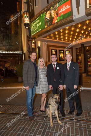 """Marc Blucas, from left, Michelle Vicary, Captain Jason Haag, service dog Axel and Bill Abbott attend a screening for Hallmark Movies & Mysteries """"Operation Christmas"""" at The Gove on in Los Angeles"""