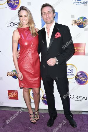Ashlan Cousteau, left, and Philippe Cousteau attend the 15th Annual Fundraising Gala: Carnivale of Play, in Universal City, Calif