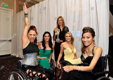 """Stock Picture of From left, Angela Rockwood, Mia Schaikewitz, Gay Rosenthal, Tiphany Adams, and Auti Angel pose backstage with their award for best reality series for """"Push Girls"""" at the Critics' Choice Television Awards in the Beverly Hilton Hotel, in Beverly Hills, Calif"""