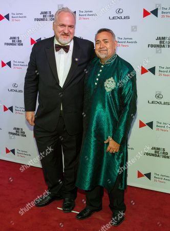 Chef Art Smith, left, and Jesus Salgueiro arrive at the 2015 James Beard Awards at Lyric Opera of Chicago, in Chicago