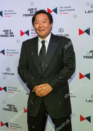 Chef Ming Tsai walks the red carpet during the 2015 James Beard Awards at Lyric Opera of Chicago on in Chicago