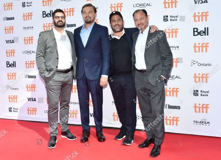 Tim Pastore, president, original programming & production, National Geographic Channel, from left, actor/producer Leonardo DiCaprio, producer Brett Ratner and director Fisher Stevens arrive at the Before the Flood premiere on day 2 of the Toronto International Film Festival at the Princess of Wales Theatre, in Toronto