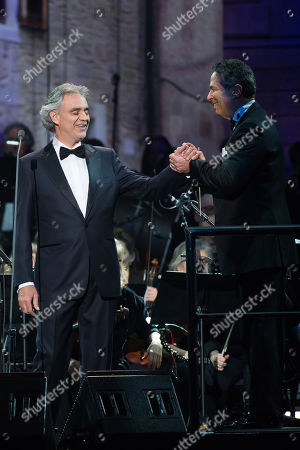 """Andrea Bocelli, left, and conductor Eugene Kohn perform in concert to support Bocelli's latest album """"Cinema"""" at Madison Square Garden on in New York"""
