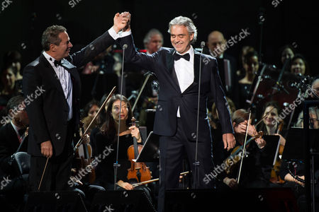"""Andrea Bocelli, right, and conductor Eugene Kohn perform in concert to support Bocelli's latest album """"Cinema"""" at Madison Square Garden on in New York"""