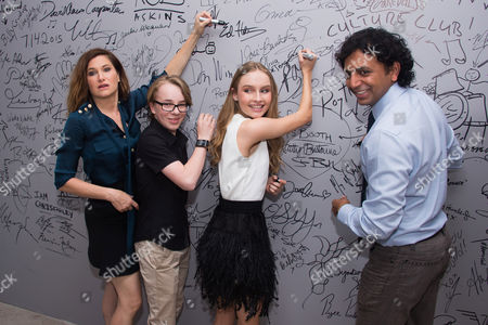 "Kathryn Hahn, from left, Ed Oxenbould, Olivia DeJonge and M. Night Shyamalan sign the wall at AOL Studios after participating in AOL's BUILD Speaker Series to discuss his film, ""The Visit"", in New York"