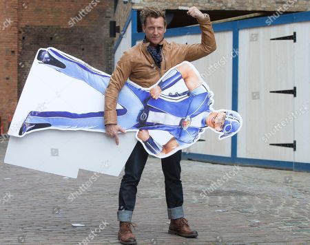Magnus Scheving, the creator and co-star of LazyTown, holds a cardboard cut-out of his character,Sportacus, during a portrait session, following an interview with the Associated Press at the Interchange, in Camden, north London