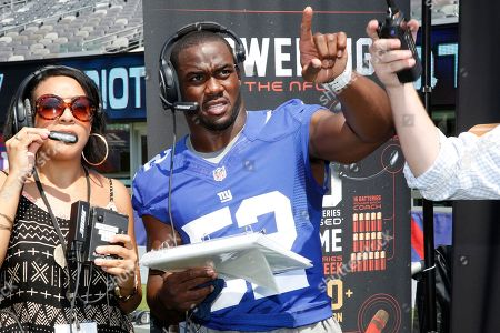 NY Giants' Jon Beason calls a play on a Duracell Quantum enabled headset at MetLIfe Stadium where more than 650 Duracell Quantum batteries are used per game, on Wed, in E.Rutherford, N.J