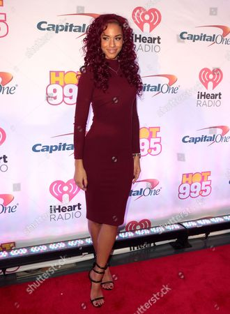 Natalie La Rose poses for photographers backstage during Hot 99.5's iHeartRadio Jingle Ball 2015 at the Verizon Center, in Washington, D.C