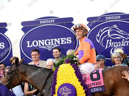 Jockey Gary Stevens, on Beholder, smiles after winning the Longines Breeders' Cup Distaff,at Santa Anita Park in Arcadia, CA. Longines, the Swiss watch manufacturer known for its elegant timepieces, is the Official Watch and Timekeeper of the Breeders' Cup World Championships and the Triple Crown
