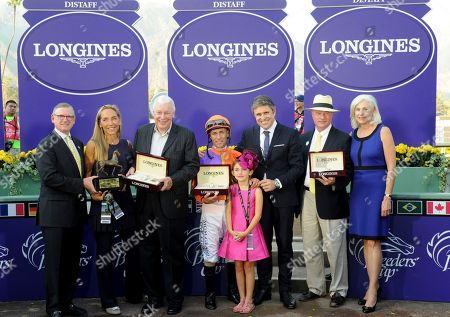 Juan-Carlos Capelli, center, Longines' VP and Head of International Marketing, presents Longines Conquest Classic timepieces to owner B. Wayne Hughes, third left, jockey Gary Stevens, center left, and trainer Richard Mandella, second right, after their horse Beholder won the Longines Breeders' Cup Distaff, at Santa Anita Park in Arcadia, CA. Longines, the Swiss watch manufacturer known for its elegant timepieces, is the Official Watch and Timekeeper of the Breeders' Cup World Championships and the Triple Crown