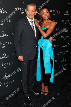 """Stock Image of President of Omega Stephen Urquhart, left, and actress Naomie Harris, right, attend a special screening of """"Spectre"""" hosted by Omega, at the AMC Loews Lincoln Square, in New York"""