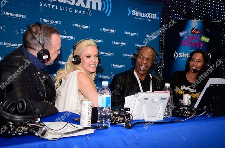 Jenny McCarthy, second from left, her husband Donnie Wahlberg, left, Mike Tyson, second from right, and his wife Lakiha Spicer talk during the broadcast of Dirty, Sexy, Funny with Jenny McCarthy on SiriusXM at the Consumer Electronics Show at the Las Vegas Convention Center on in Las Vegas