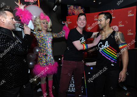 "VODKA-Patrik Gallineaux, left, LGBT Ambassador for Stoli, and ""Showbiz Spitfire"" Paige Turner, announce Mark Murphy, second right, bartender for El Vez, as The Stoli Key West Cocktail Classic New York Regional Champion, at Boxers HK in New York, as runner-up Davidson Adams looks on. Murphy will go on to compete for the 2016 Champion title in Key West during Key West Pride 2016"