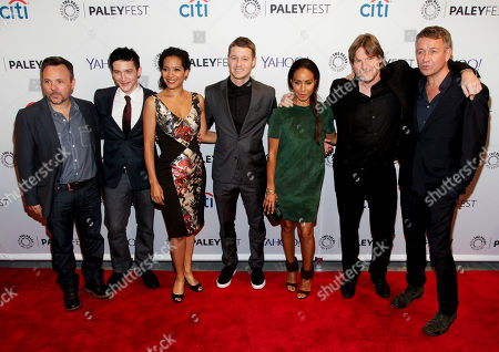 """From left to right, Danny Cannon, Robin Lord Taylor, Zabryna Guevara, Benjamin McKenzie, Jada Pinkett Smith, Donal Logue and Sean Pertwee attend the PaleyFest New York """"Gotham"""" panel discussion during The William S. Paley Television Festival at The Paley Center for Media, in New York"""