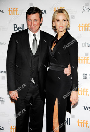 """Janet Jones Gretzky, a cast member in """"The Sound and the Fury,"""" poses with her husband, pro hockey great Wayne Gretzky, at the premiere of the film at Ryerson Theatre during the Toronto International Film Festival, in Toronto"""