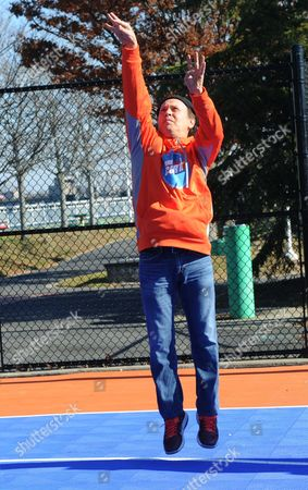 Actor and comedian Billy Crystal makes a jump shot at the opening ceremony for two new DreamCourts, in Long Beach, N.Y. The courts were constructed and opened today, one-year post Hurricane Sandy, thanks to the Nancy Lieberman Foundation, WorldVentures Foundation and Billy and Janice Crystal