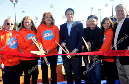 Steve Kohut, WorldVentures Foundation Executive Director Gwyneth Lloyd, Basketball Hall of Famer Nancy Lieberman, New York State Governor Andrew Cuomo, Billy and Janice Crystal and New York State Senator Dean Skelos, left to right, cut the ribbon for two new DreamCourts, in Long Beach, N.Y. The courts were constructed and opened today, one-year post Hurricane Sandy, thanks to the Nancy Lieberman Foundation, WorldVentures Foundation and Billy and Janice Crystal