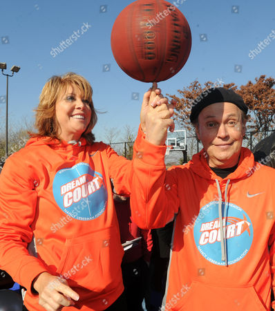 Actor and comedian Billy Crystal, right, joins basketball Hall of Famer Nancy Lieberman at the opening ceremony for two new DreamCourts, in Long Beach, N.Y. The courts were constructed and opened today, one-year post Hurricane Sandy, thanks to the Nancy Lieberman Foundation, WorldVentures Foundation and Billy and Janice Crystal
