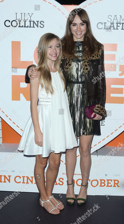 From left, actors Lily Laight, and Suki Waterhouse pose for photographers upon arrival at the after party for the premiere of the film Love, Rosie, at Bounce in central London
