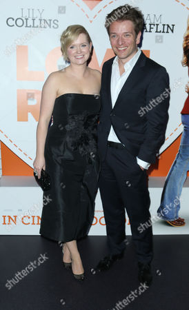 Christian Ditter and Cecelia Ahern pose for photographers upon arrival at the after party for the premiere of the film Love, Rosie, at Bounce in central London