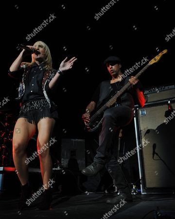 Emily Haines and Joshua Winstead of Metric perform during The Self-Titled Tour at the BB&T Center on in Sunrise, Florida